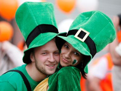 Happy couple portrait St Patrick's day parade in an Irish village.. Adobe RGB