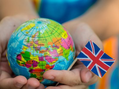 Globe in hand with the UK flag