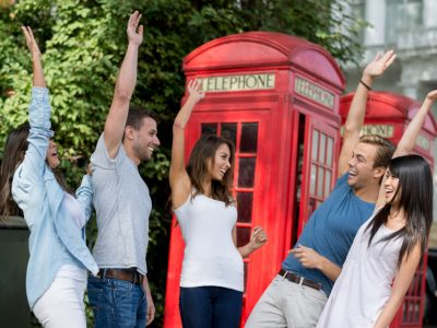 Group of exchange students in London giving a high-five - teamwork concepts